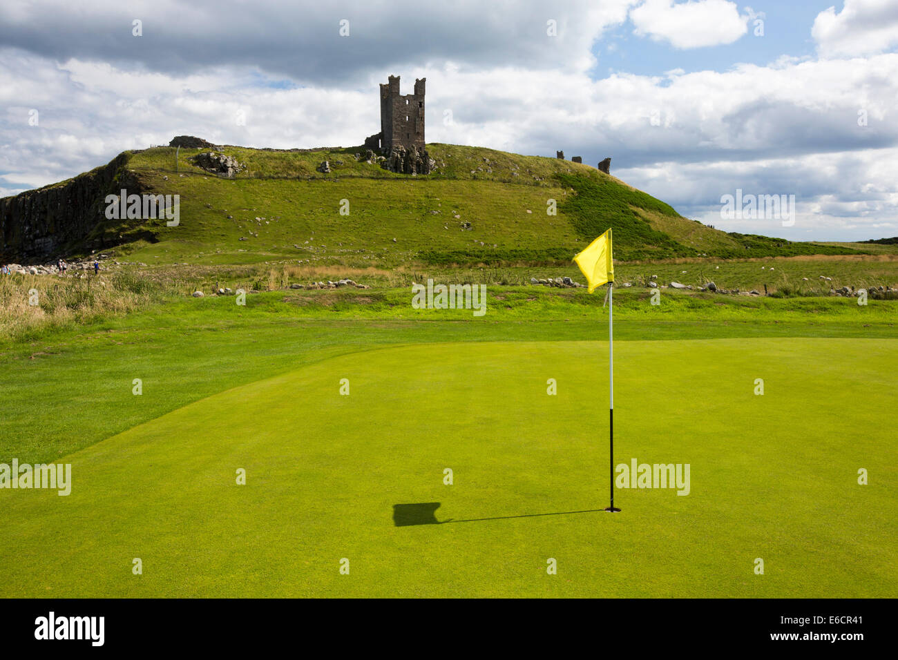 Dunstanburgh Castle and gof course near Craster in Northumberland, UK. - Stock Image