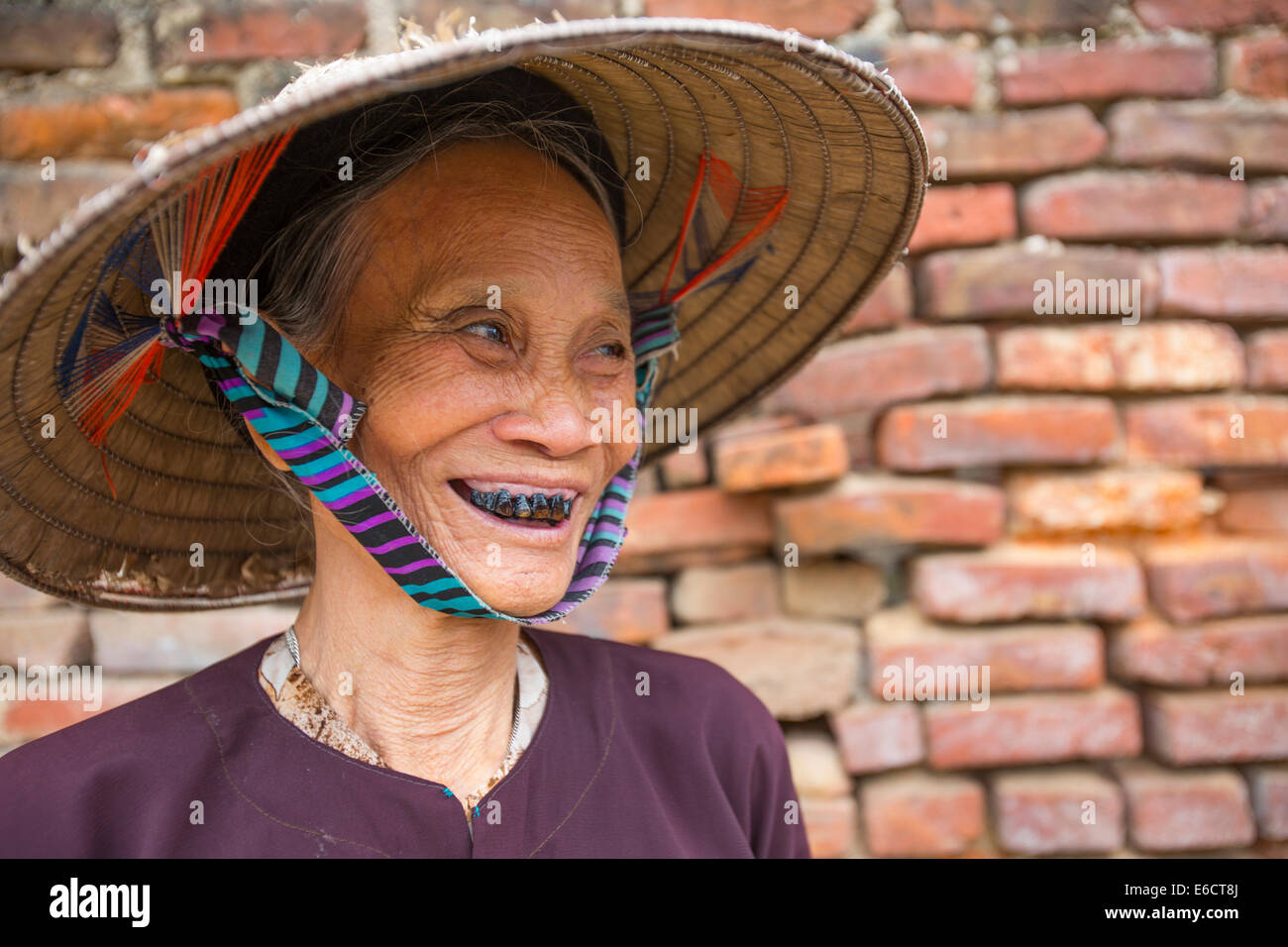 Vietnamese woman with black teeth from chewing betel nuts in Hanoi Long Khe village - Stock Image