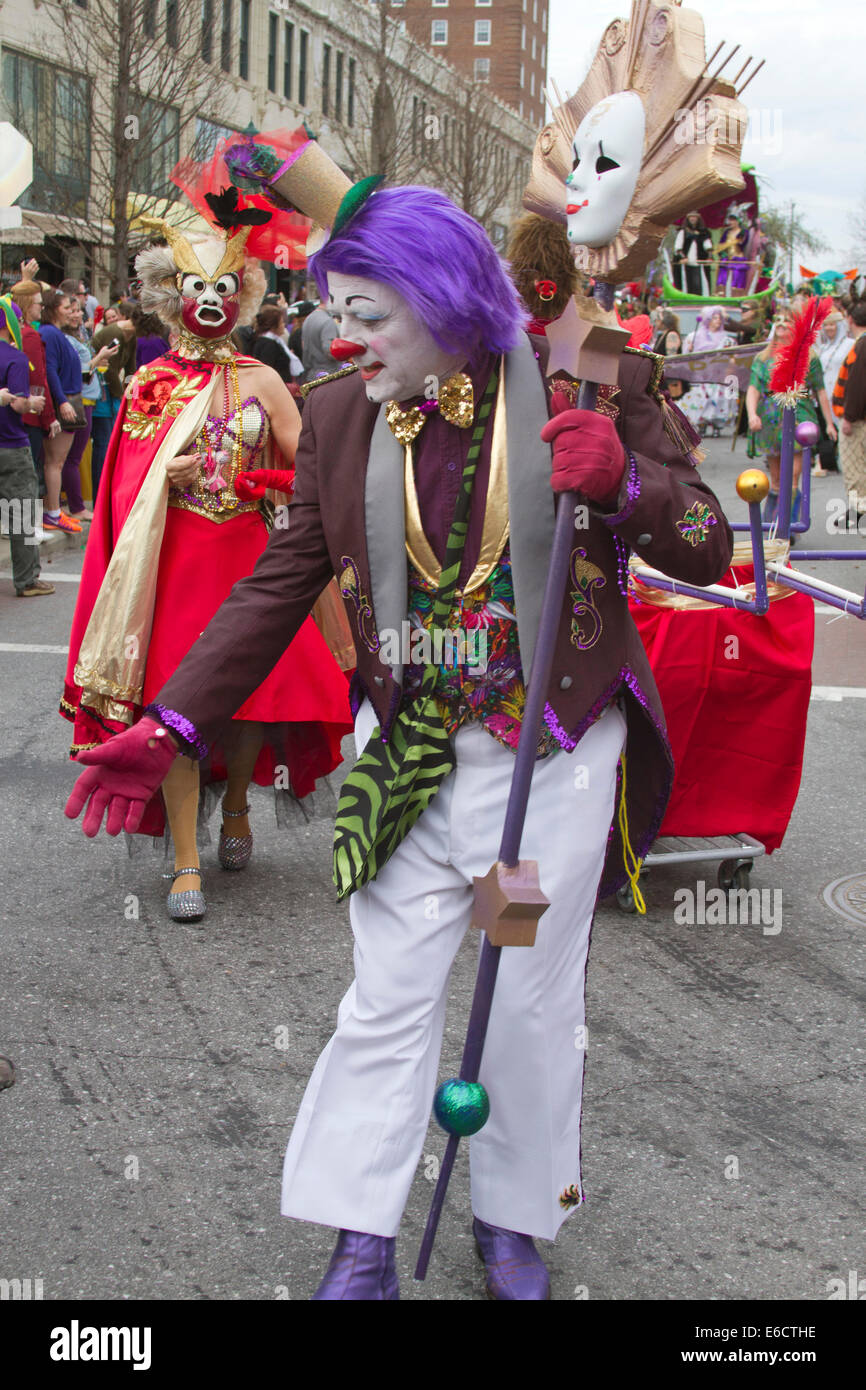 Asheville, North Carolina, USA - March 2, 2014:  A colorful and personable clown marches in the Mardi Gras parade - Stock Image