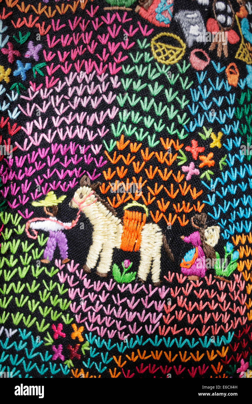 Detail of a hand stitched blanket depicting a man leading his donkey followed by his wife, Patzcuaro, Michoacan, - Stock Image