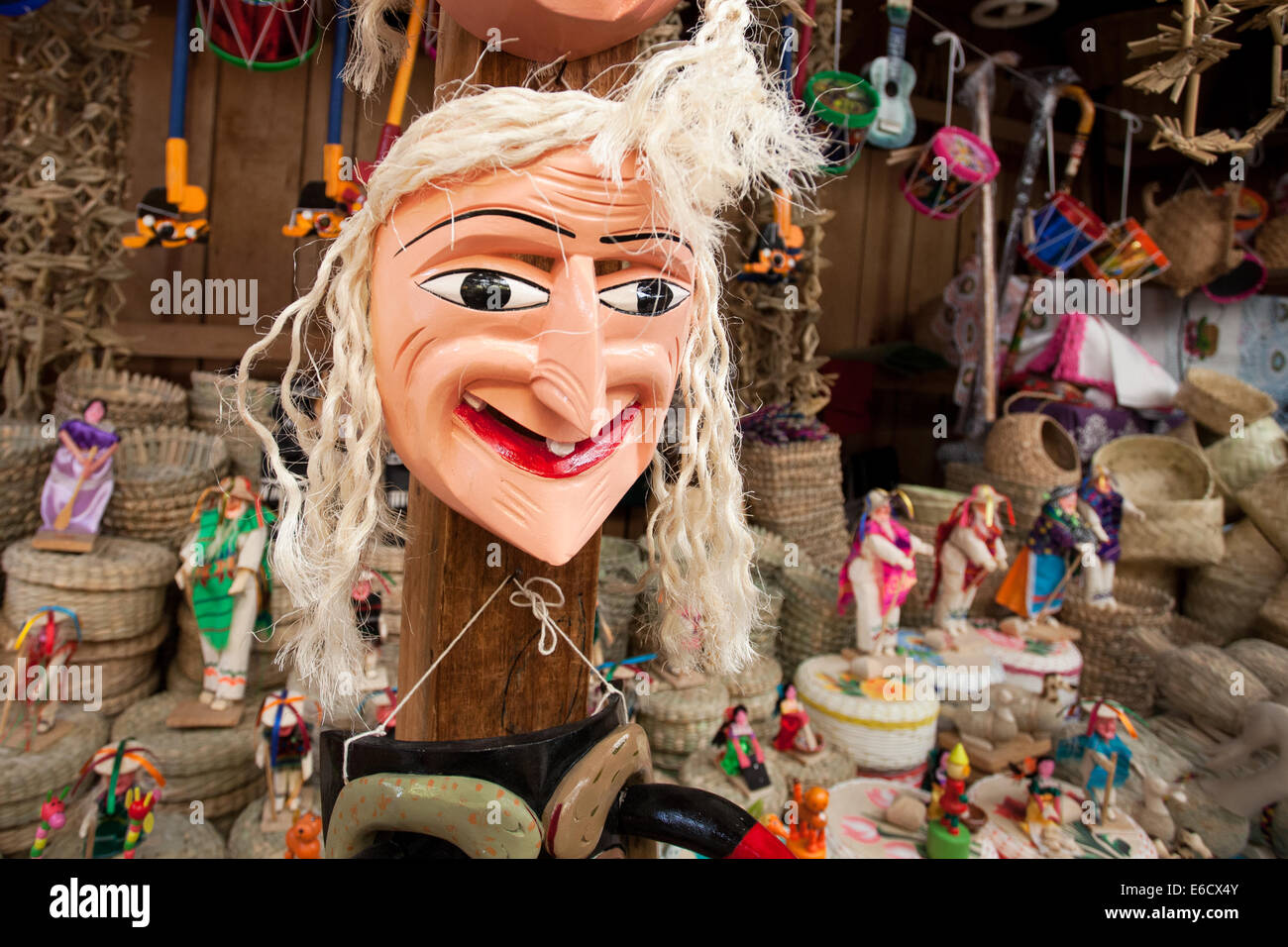 Bit of a bad hair day for a mask that is used in the popular Old Man's Dance in a market in Patzcuaro, Michoacan, - Stock Image