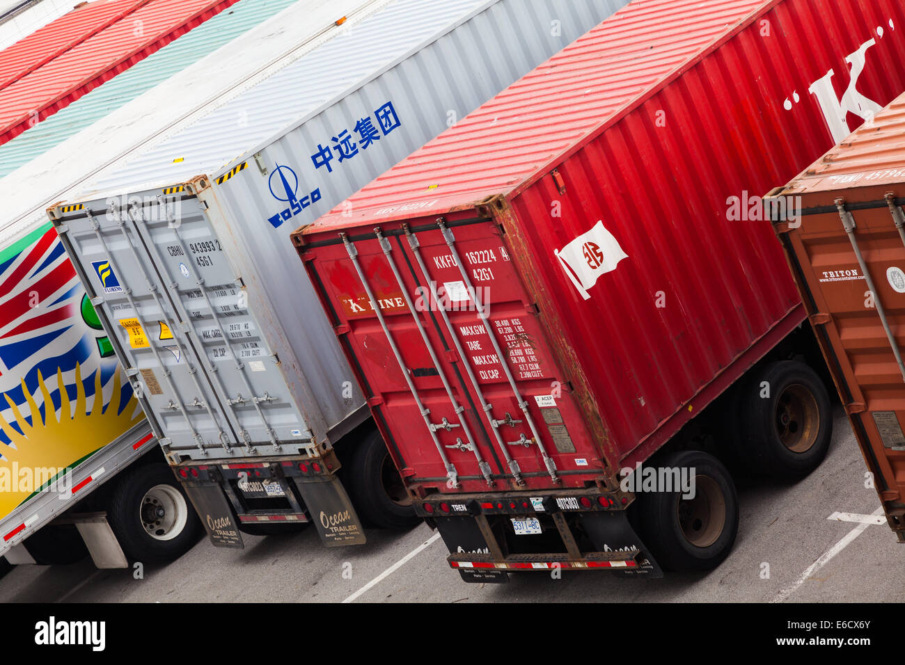 Abstract view of shipping containers loaded on to delivery trucks in Vancouver, Canada - Stock Image