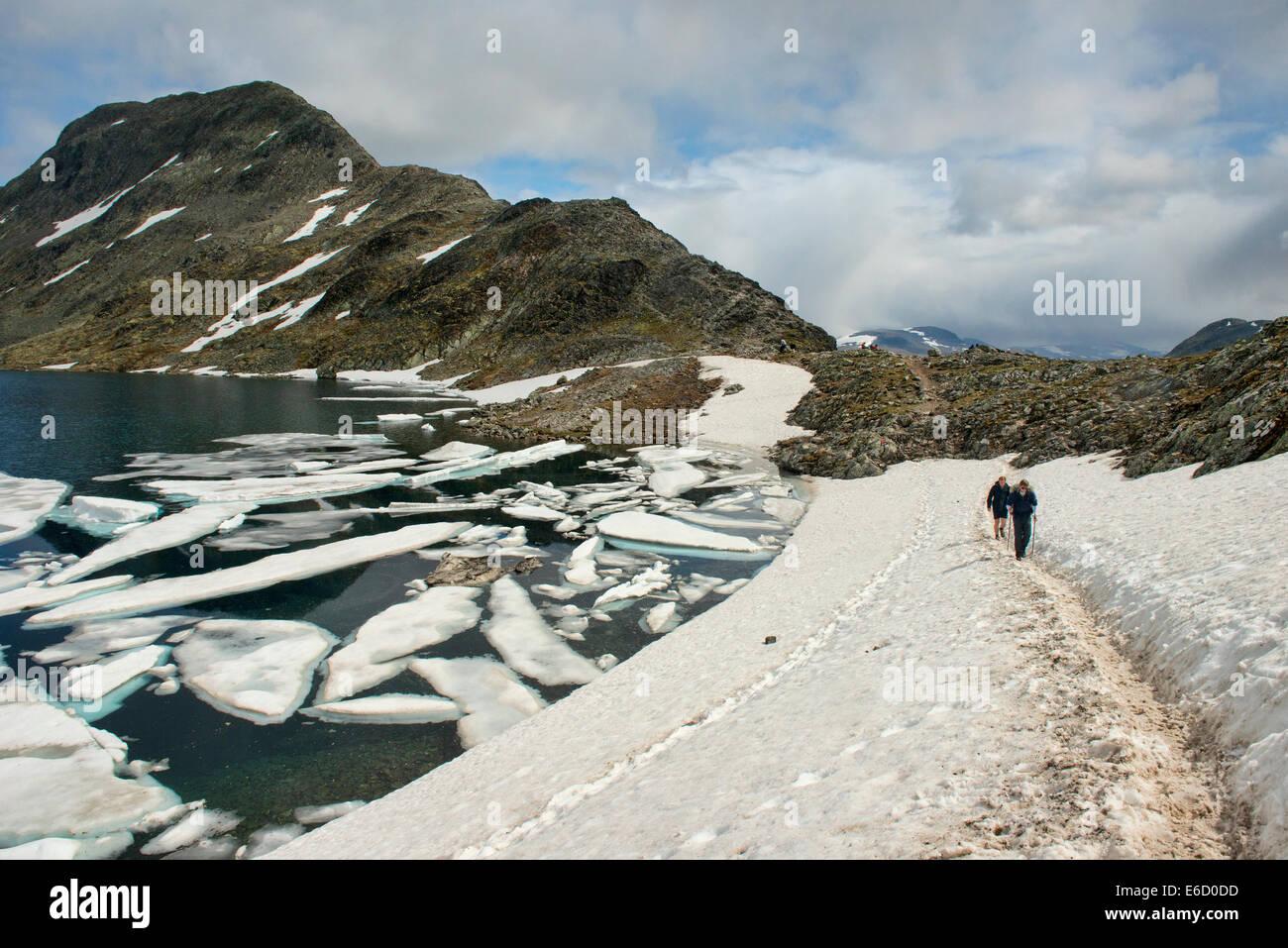 Hikers on the Besseggen Ridge trek in Jotunheimen National Park, Norway - Stock Image