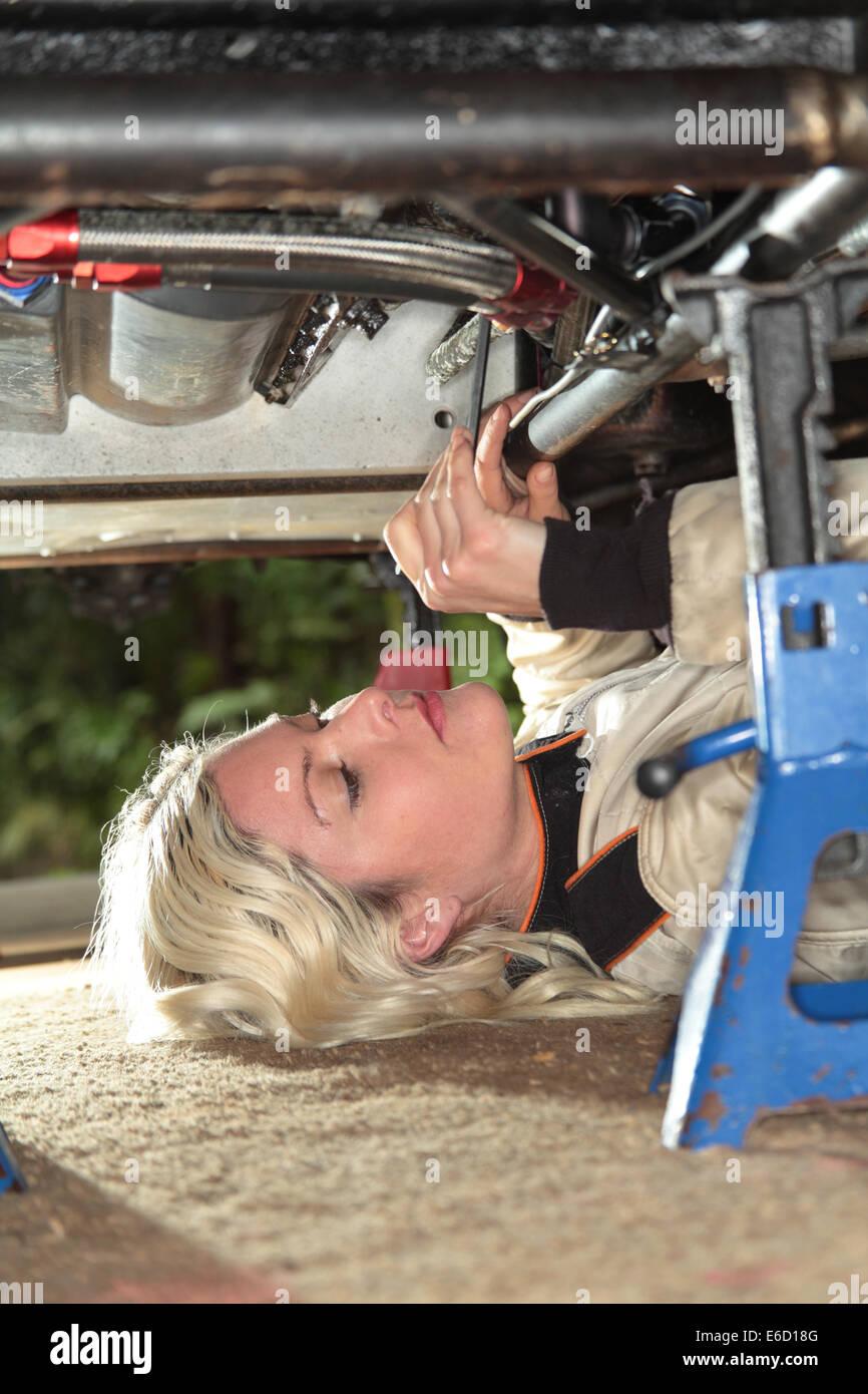 woman fixed her midget race car - Stock Image