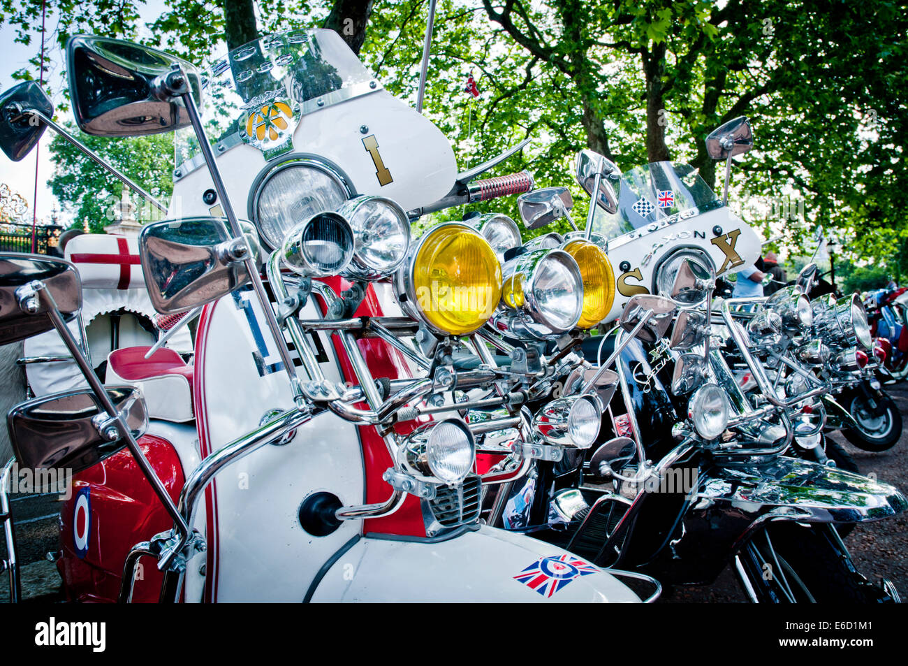 Mod Lambretta and Vespa Scooters at a rally in Regents Park, London - Stock Image