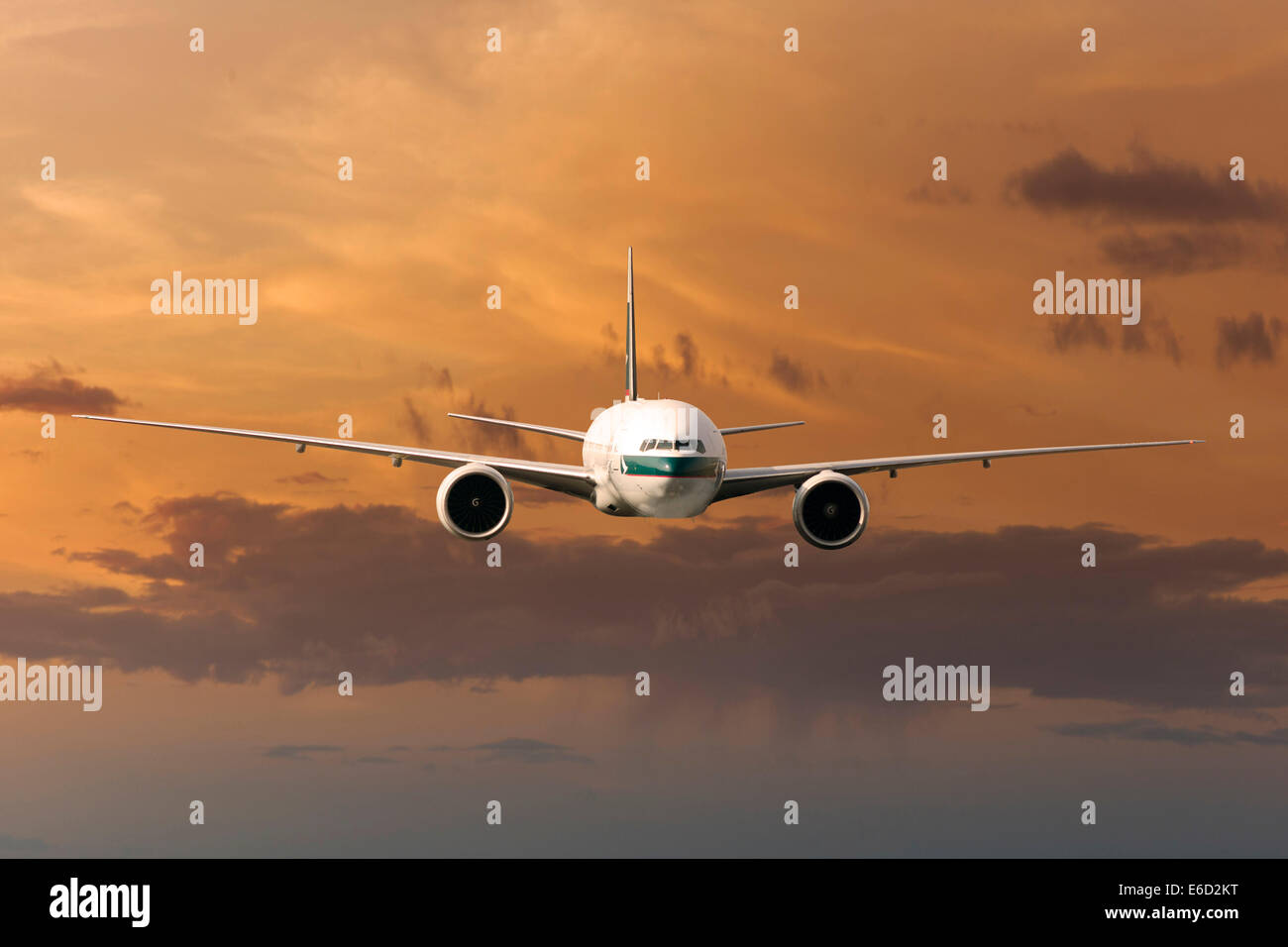 Cathay Pacific Boeing 777-367 ER in flight in the evening light - Stock Image