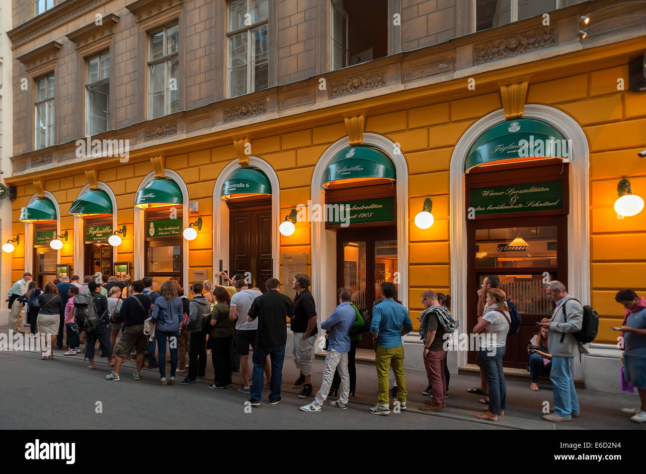 Tourists wait in long queues in front of the famous Schnitzel restaurant Figlmüller, Vienna, Vienna State, - Stock Image