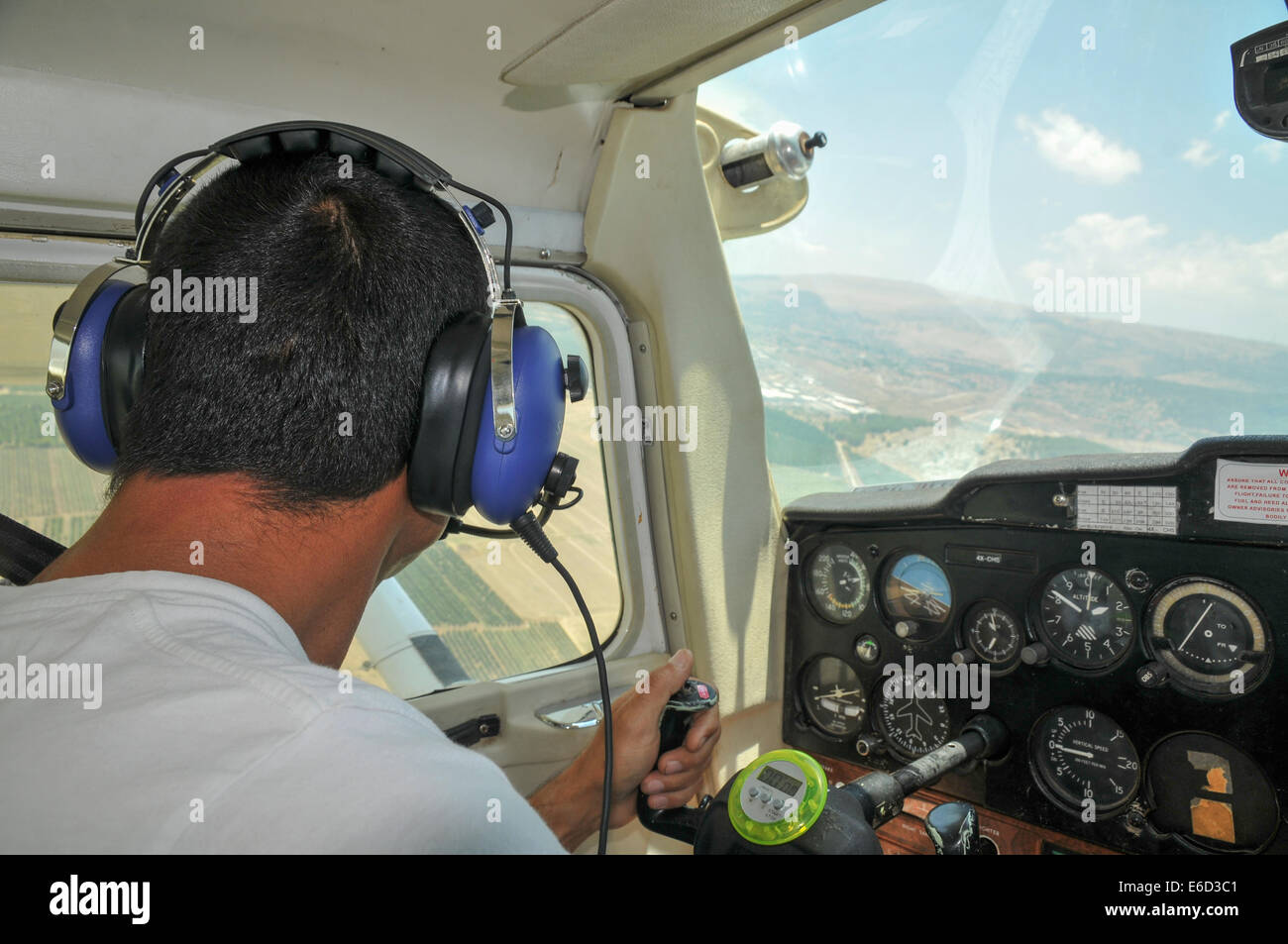 Pilot flying a Cessna plane - Stock Image