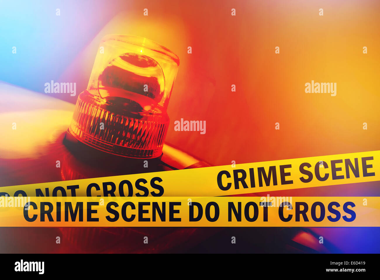 Crime Scene Do Not Cross Yellow Headband Tape and Orange flashing and revolving light. Criminal Scene Police Ribbon. - Stock Image