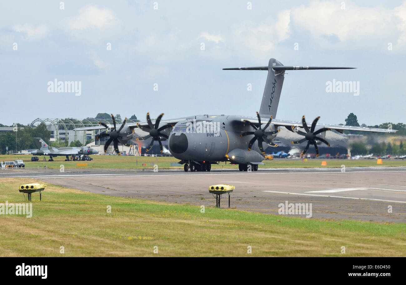 An Airbus A400M military transport plane takes off at Farnborough International Airshow. 2014 - Stock Image