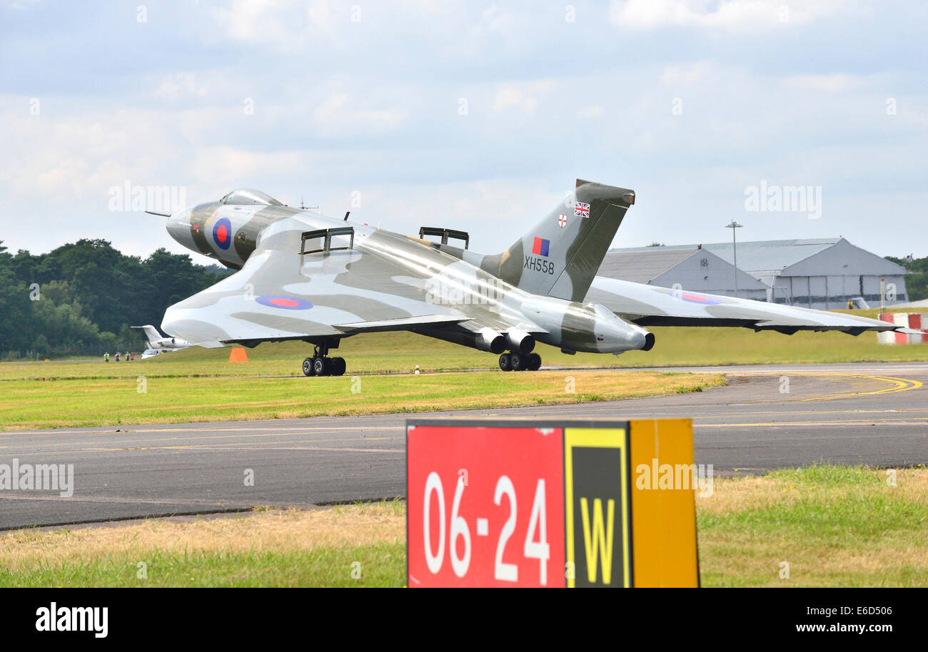 The world's last remaining flying Avro Vulcan bomber takes off  what is likely to be its final Farnborough appearance. - Stock Image