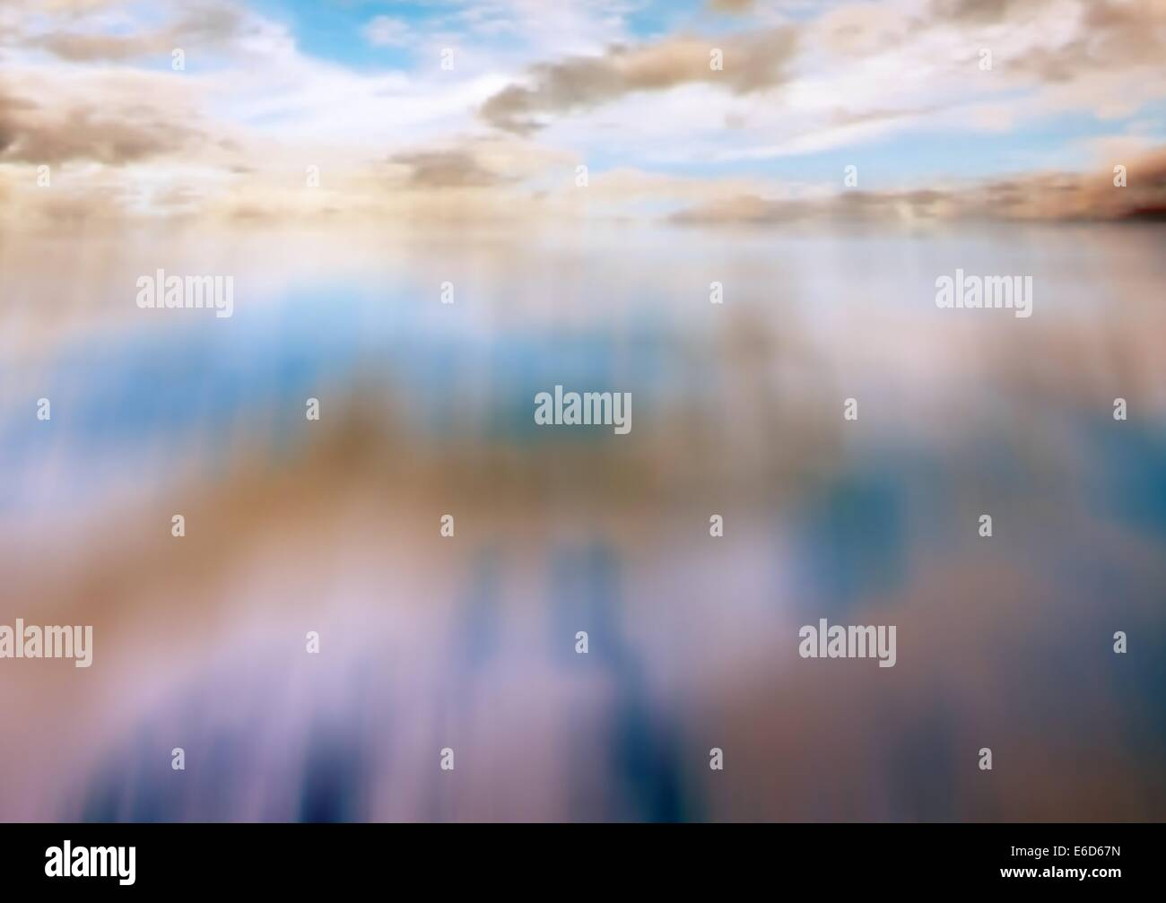 Editable vector illustration of a cloudy sky reflected in water - Stock Vector