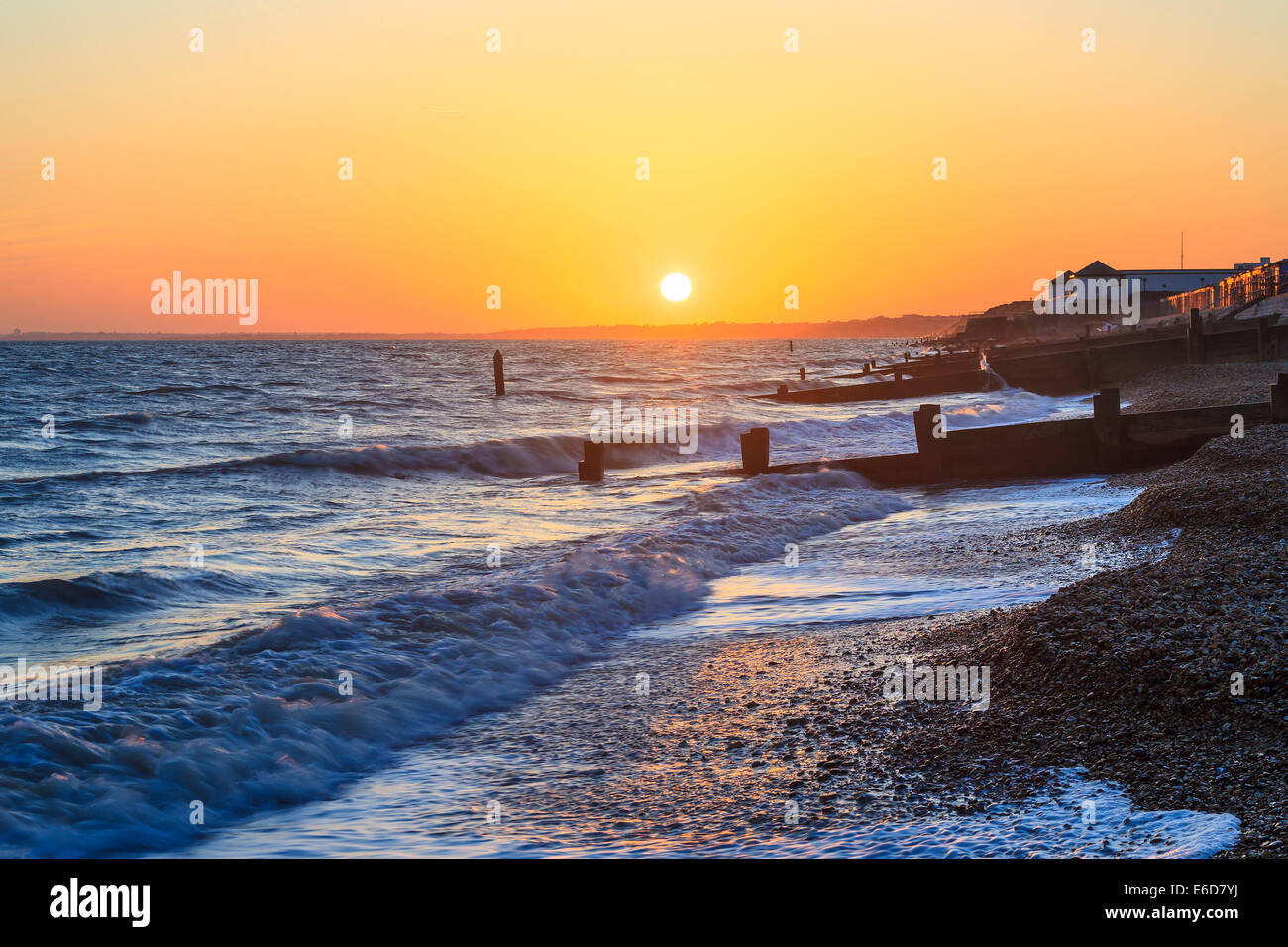 Groynes at sunset in Milford-on-Sea Hampshire England UK Europe - Stock Image