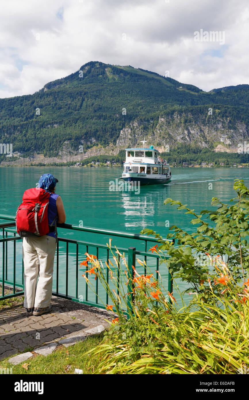 Austria, Salzkammergut, Salzburg State, Lake Wolfgangsee, Sankt Gilgen, Fuerberg, Female hiker at landing stage - Stock Image