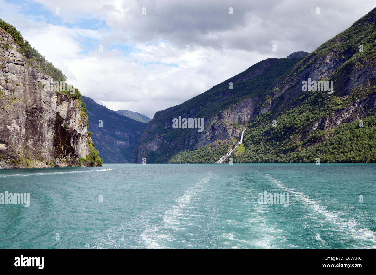 Geiranger Fjord in southern Norway is one of the most beautiful fjords. The sheer cliffs rise straight from the - Stock Image