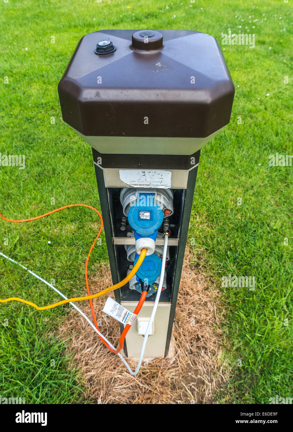 An electricity supply box with connections and cables on a Caravan Club campsite in England, UK. - Stock Image