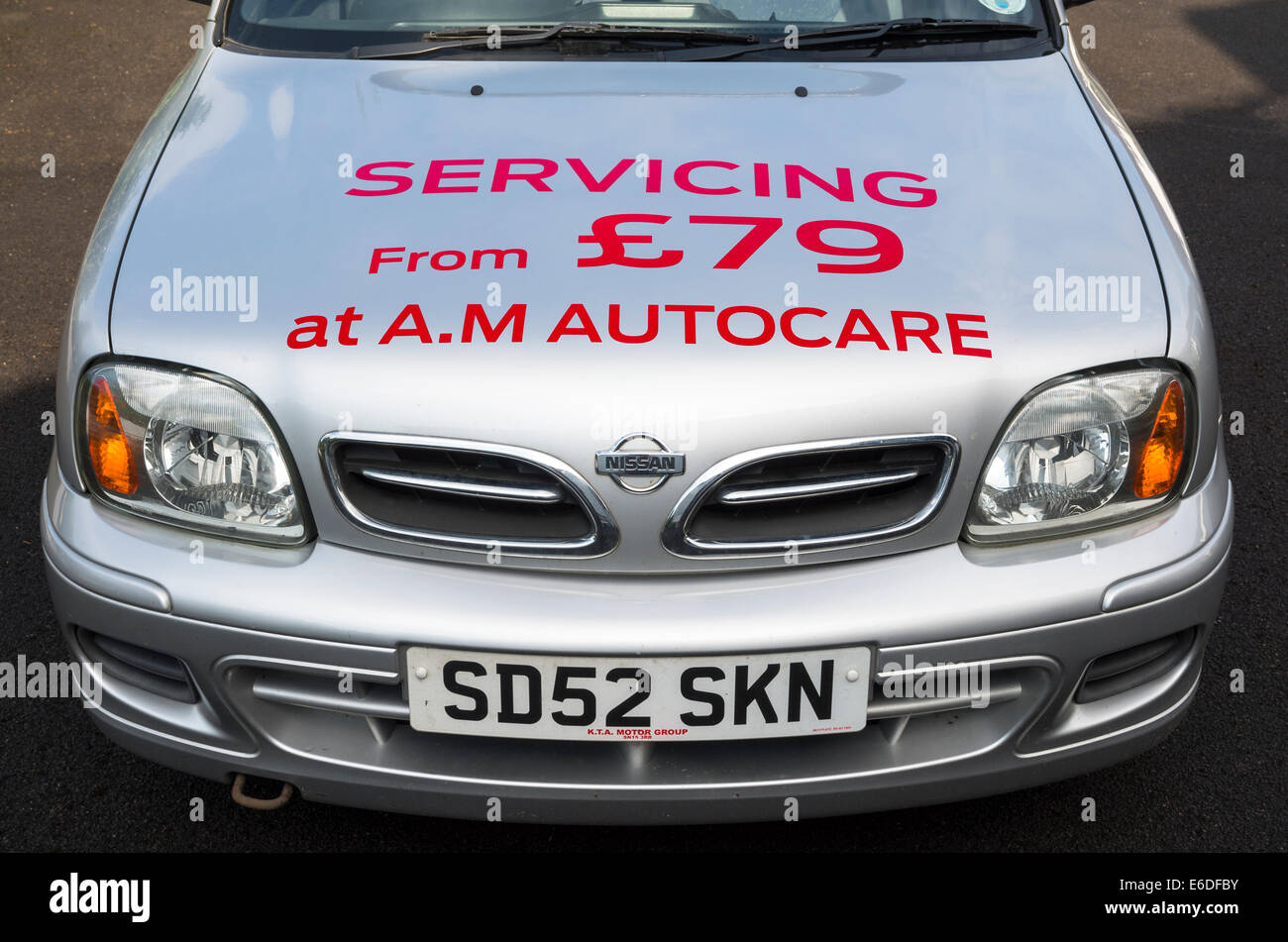 Car servicing promotion printed on loan car bonnet - Stock Image