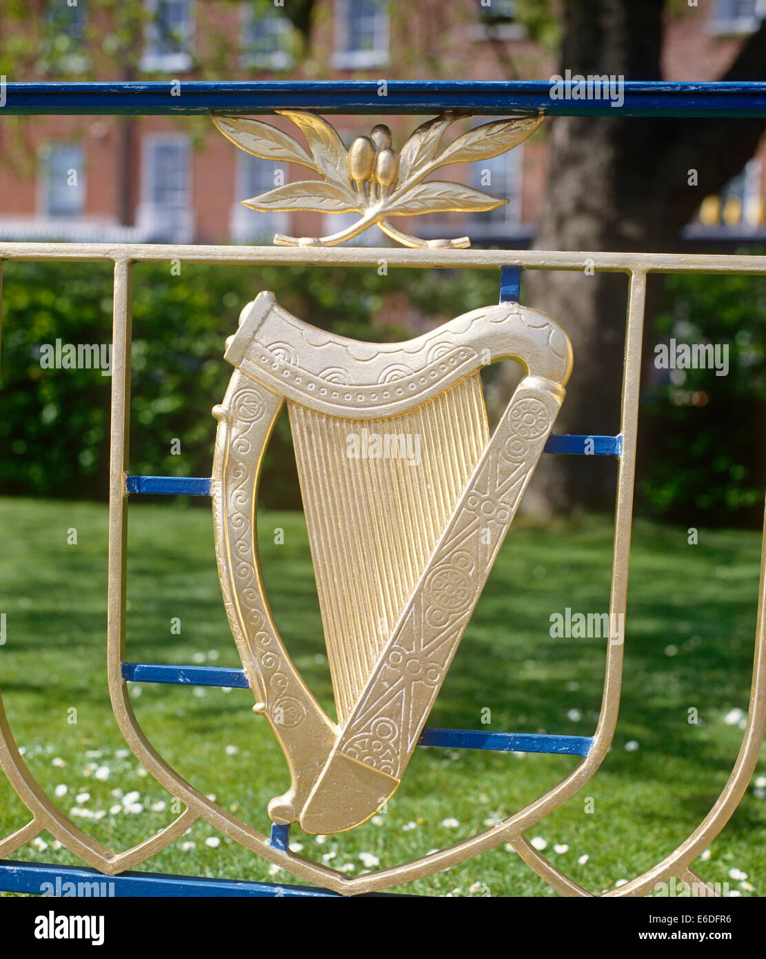 Harp on railings Memorial gardens Dublin Ireland - Stock Image