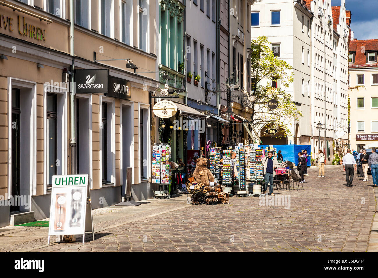 A busy street of souvenir shops and jewellers in the Nikolaiviertel or Nicholas Quarter in berlin. - Stock Image