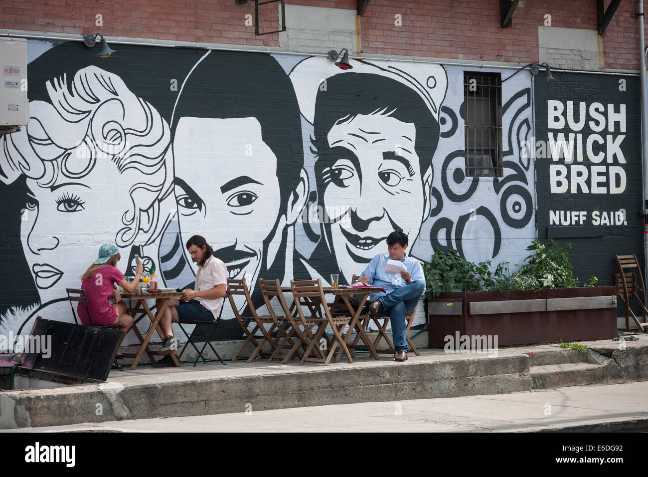 Diners at an outdoor cafe in the bushwick neighborhood of brooklyn in new york stock