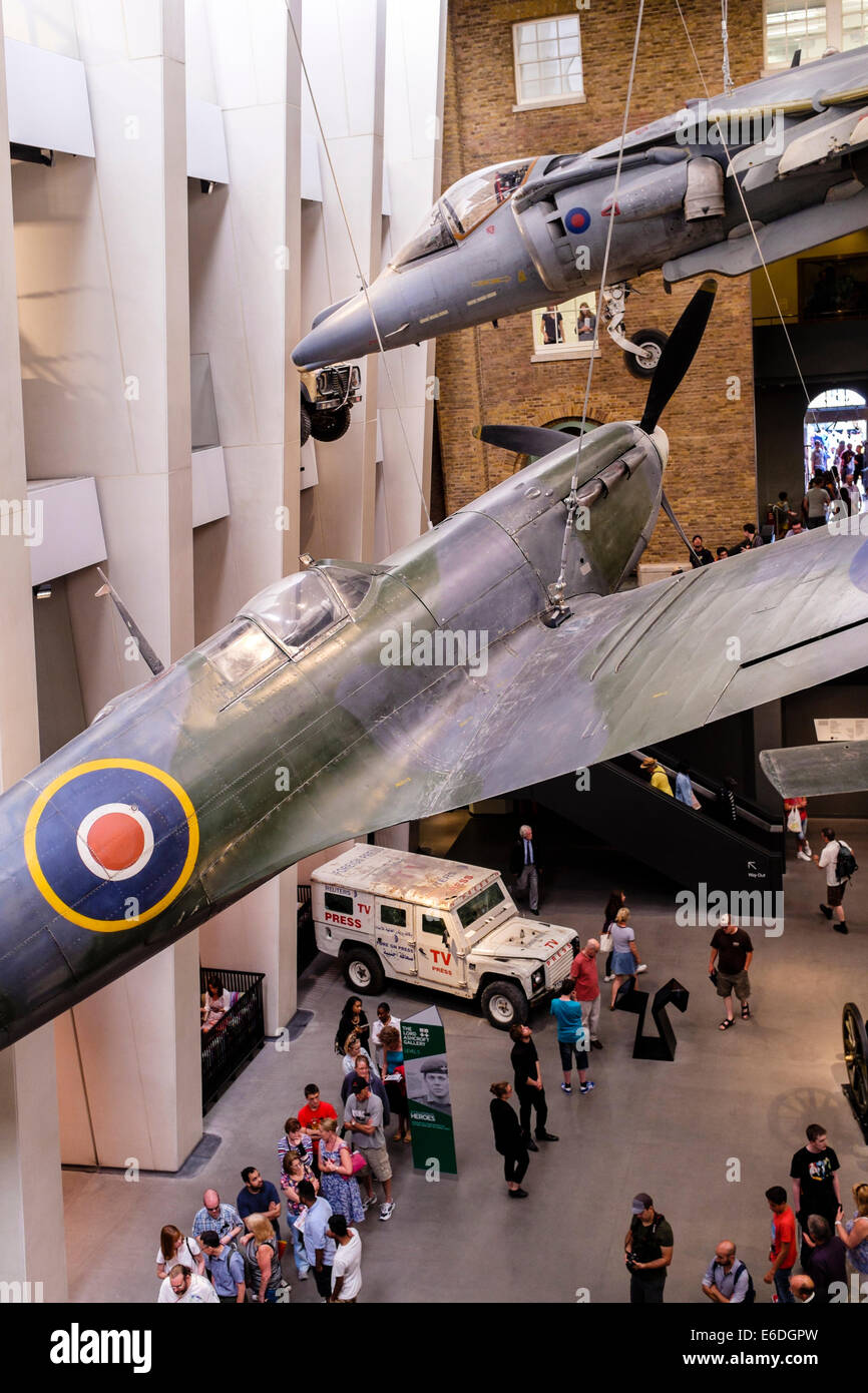 Spitfire and Harrier aircraft on display at Imperial War Museum, London UK - Stock Image