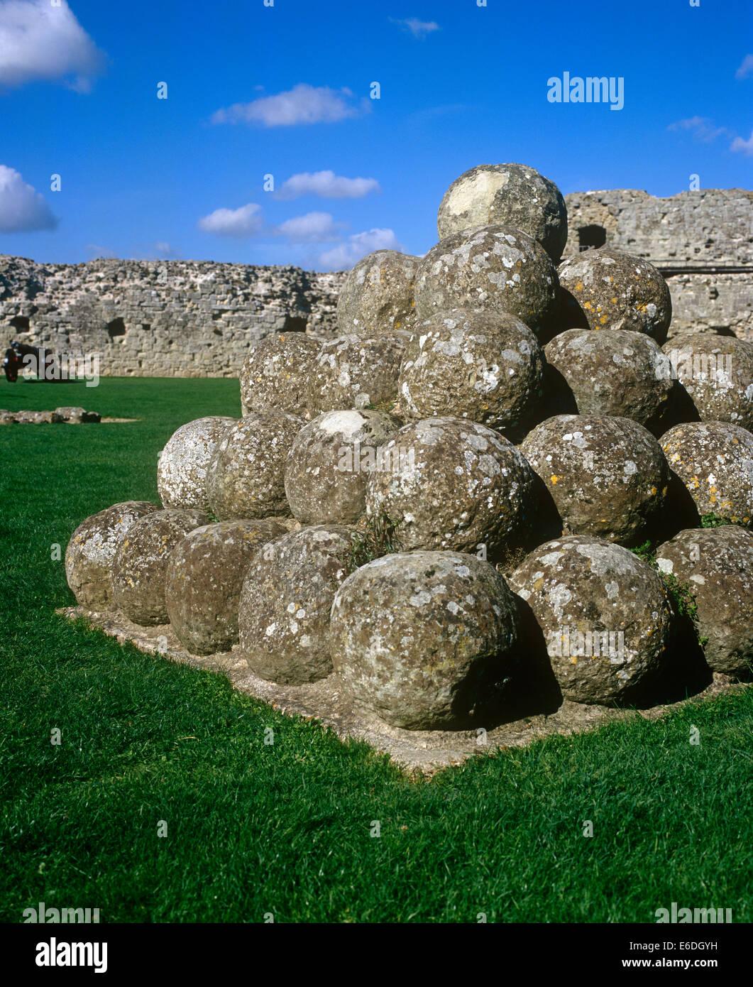 canon balls pevensey castle sussex uk - Stock Image