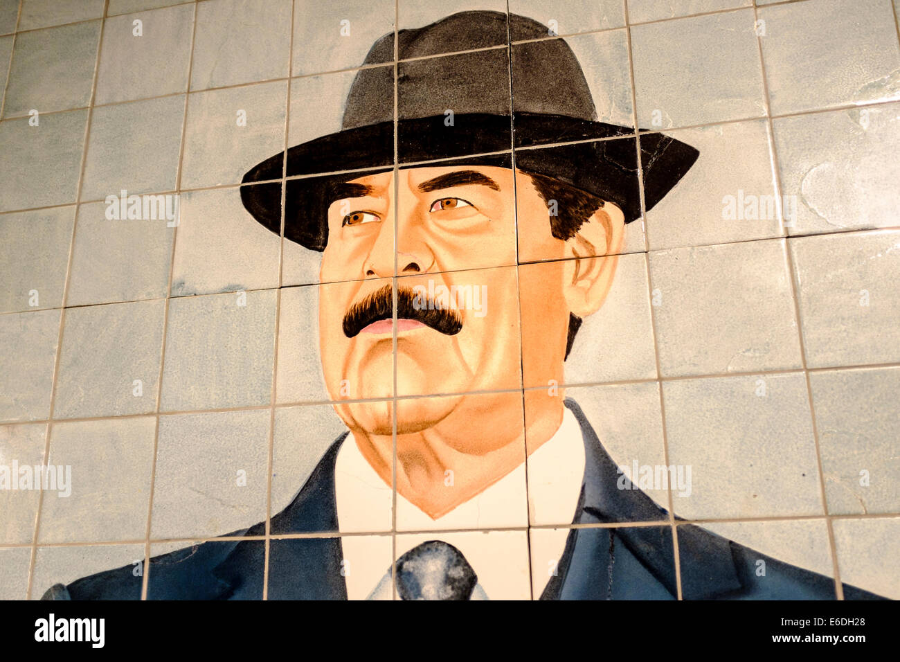 Tile mosaic of Saddam Hussein on display at the Imperial War museum, London, UK - Stock Image