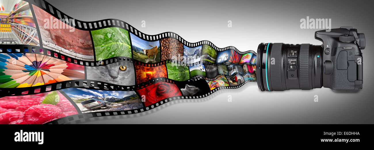 dslr camera with film strips - Stock Image