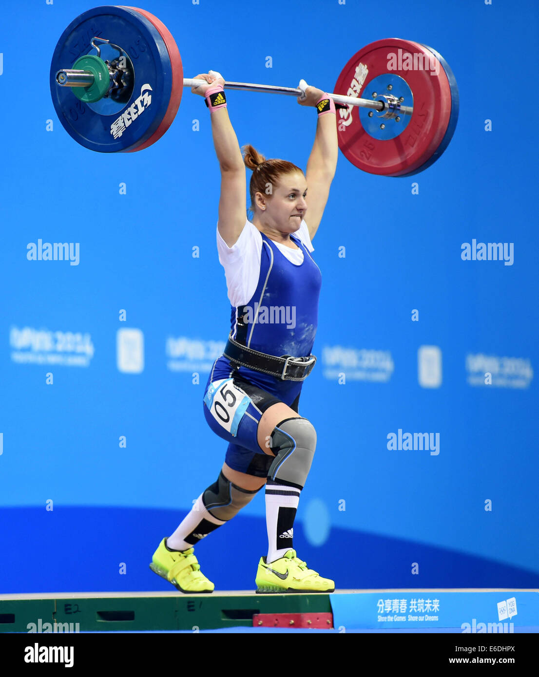 Nanjing, China's Jiangsu Province. 21st Aug, 2014. Zenchenko Sofiya of Ukraine competes during women's 63kg of weightliftingStock Photo