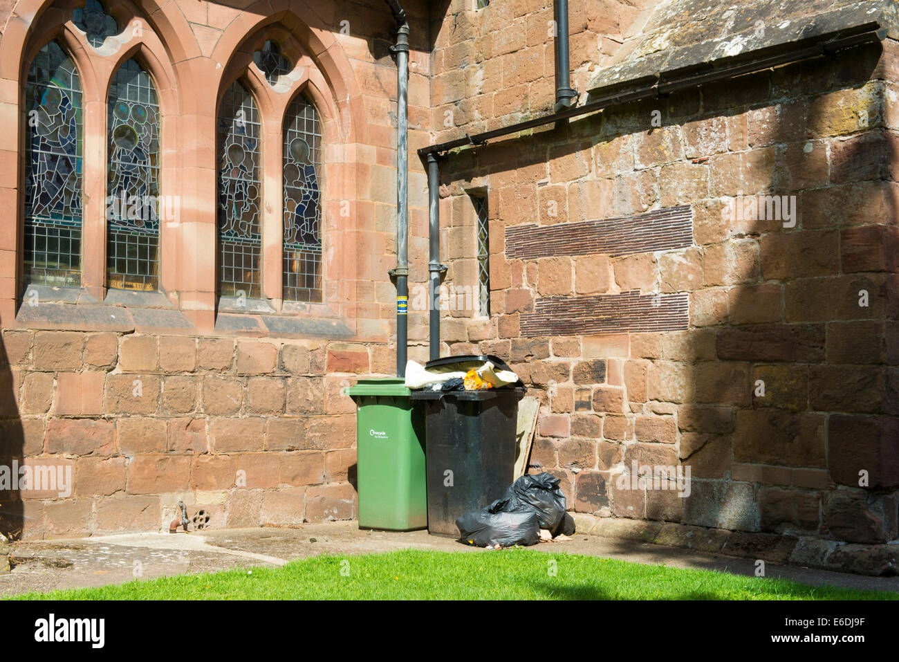 Rubbish bins outside St Andrew's Church in Shifnal, Shropshire, England - Stock Image