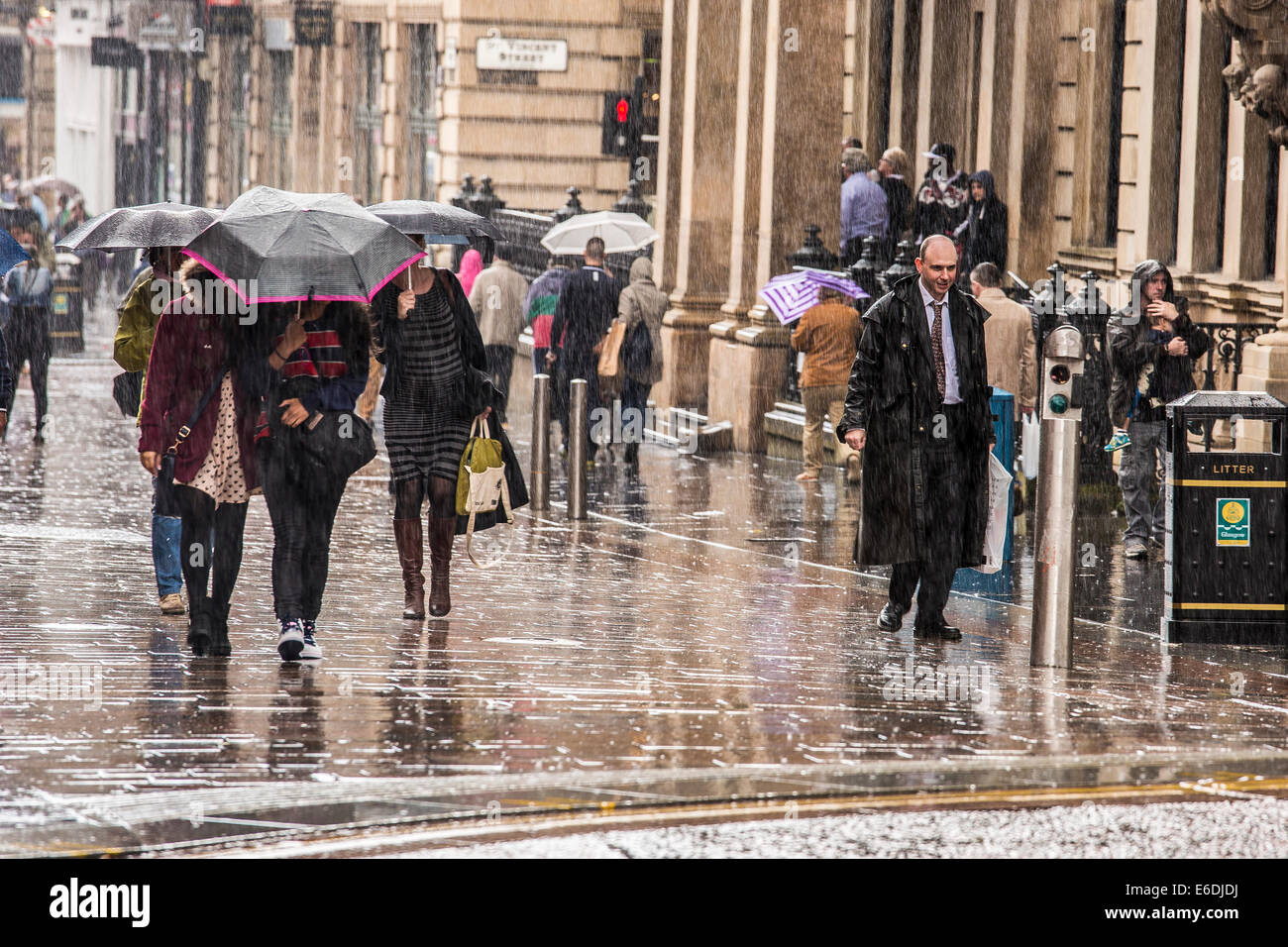 Many people get soaked as torrential rain lashes down during a lunchtime walk. Buchanan Street, Glasgow, Scotland, - Stock Image