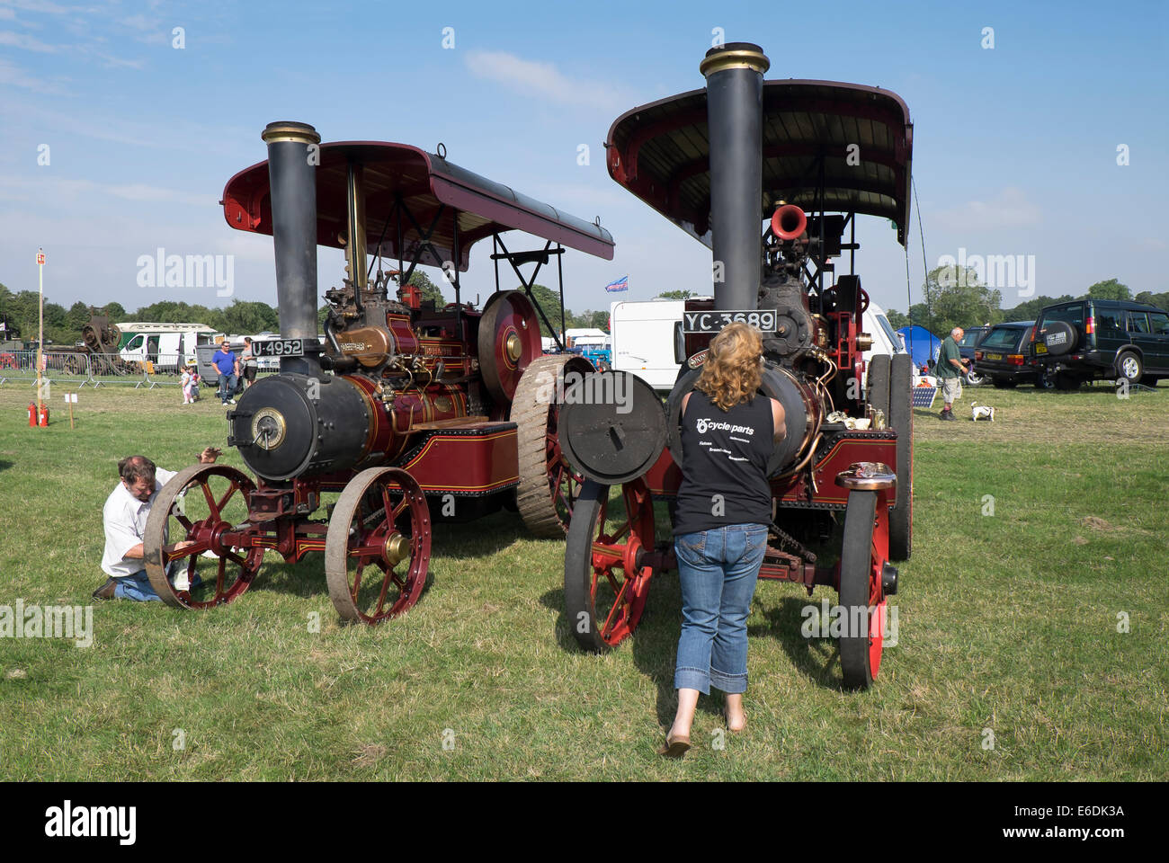 Two John Fowler steam engines being prepared for show at show ground for Cambridgeshire Steam Rally and Country Stock Photo