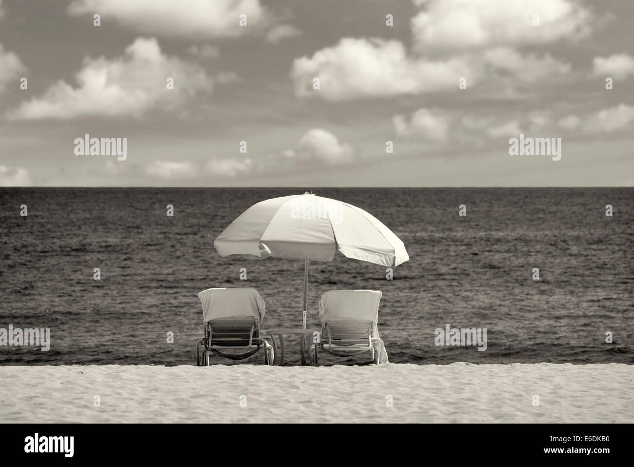 Beach umbrella and chairs. Beach at Four Seasons, Lanai, Hawaii. - Stock Image