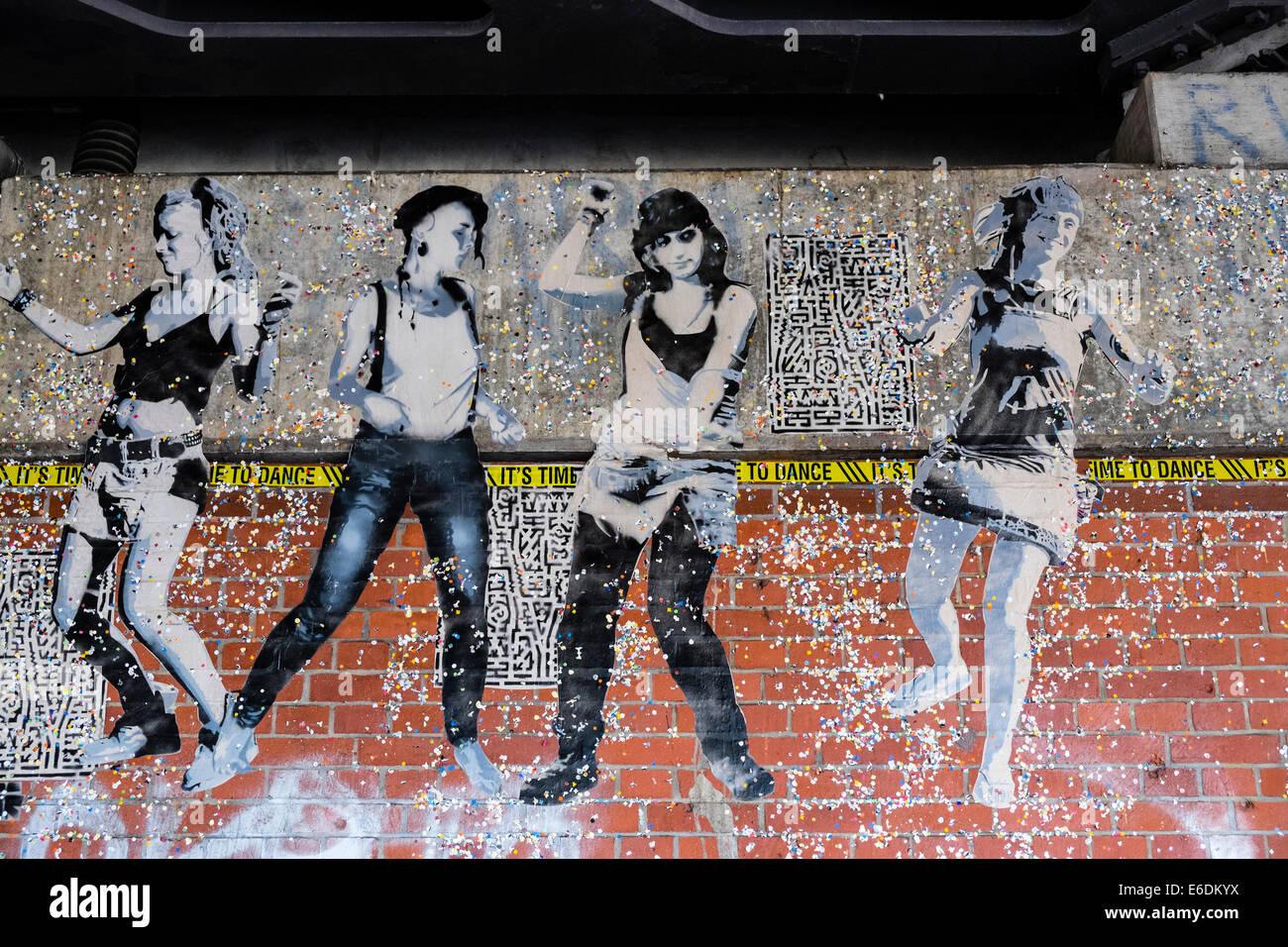 Stenciled street art graffiti on wall in Berlin Germany - Stock Image