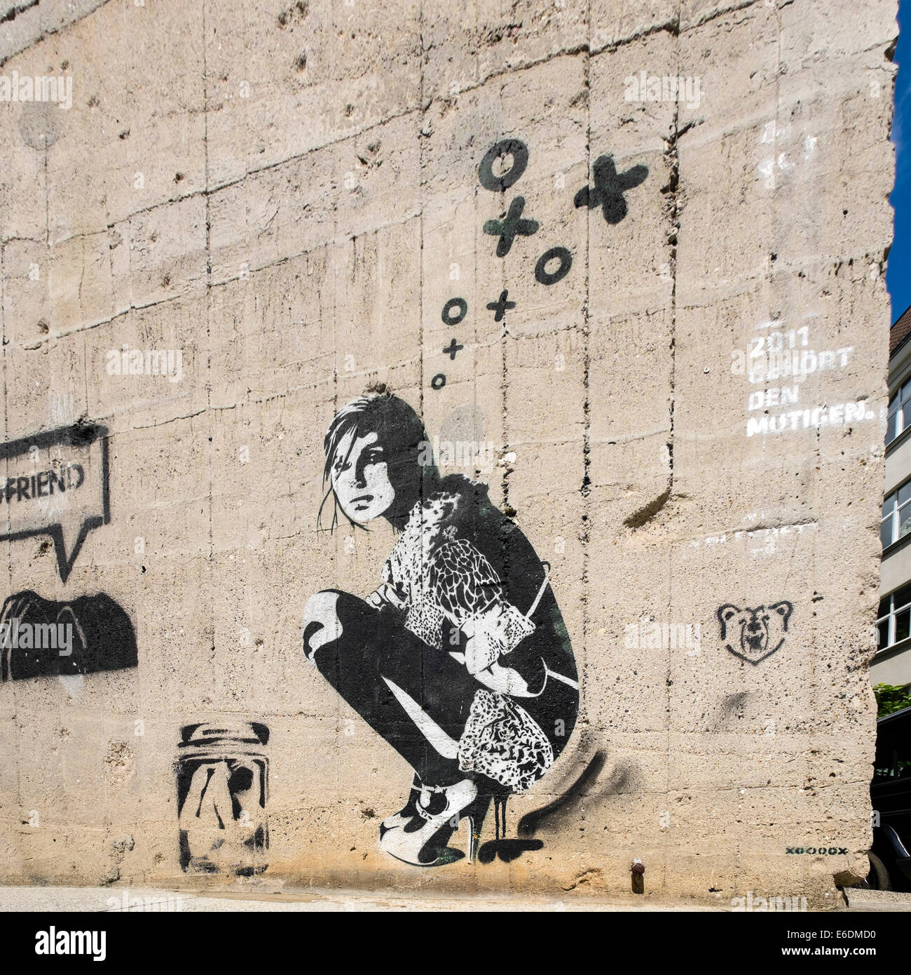 Stenciled street art by prominent artist xoooox in Berlin Germany - Stock Image