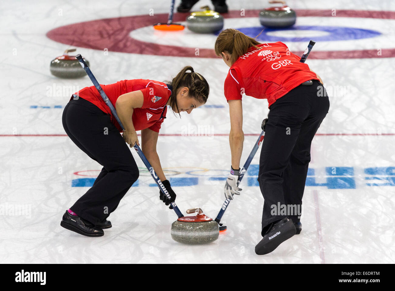 Vicki Adams (L) and Claire Hamilton of Team Great Britain sweeping during  Women's curling competition at the - Stock Image