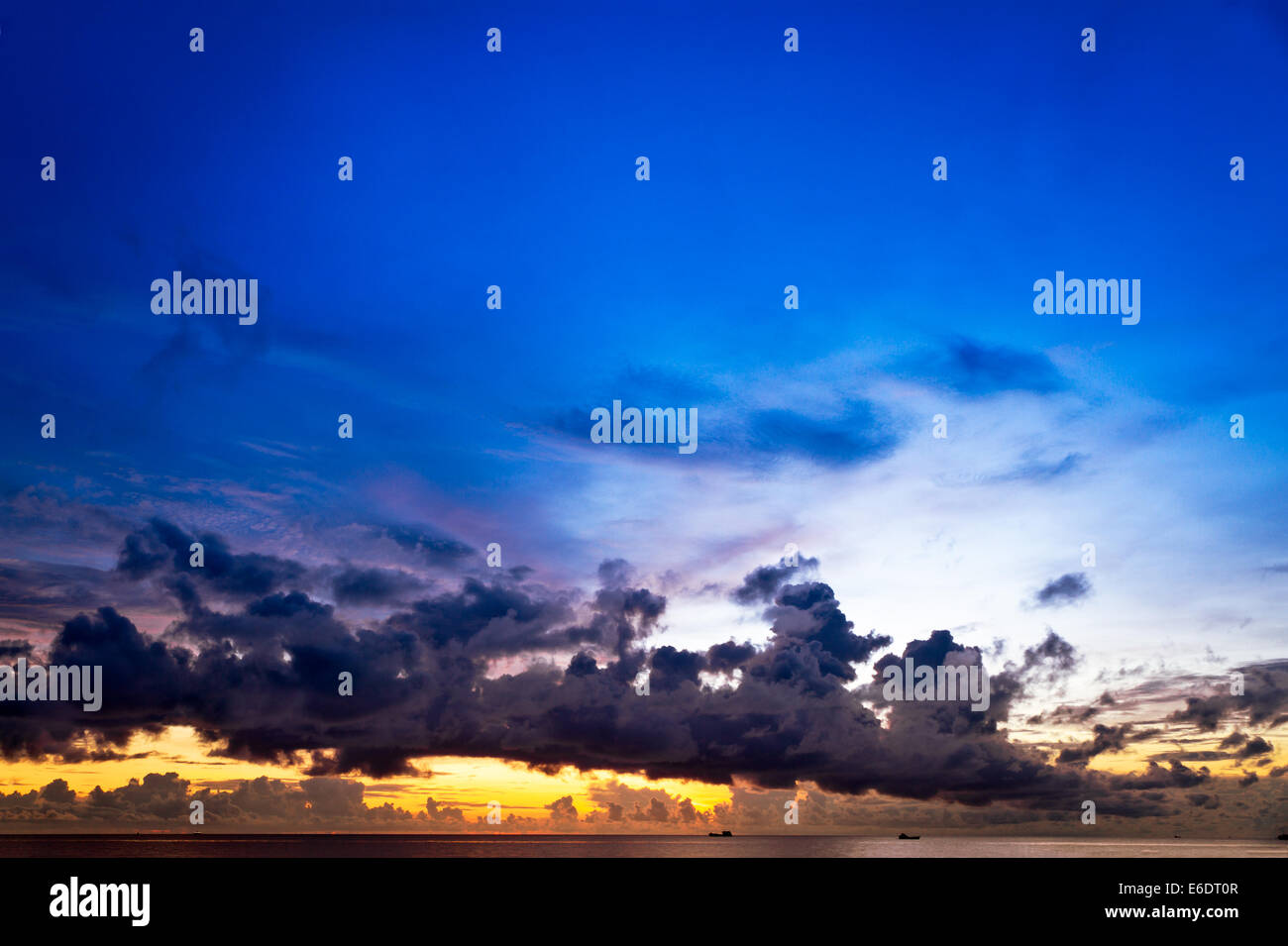 Sunset at South China Sea with big skies and ships, Phu Quoc, Vietnam Stock Photo