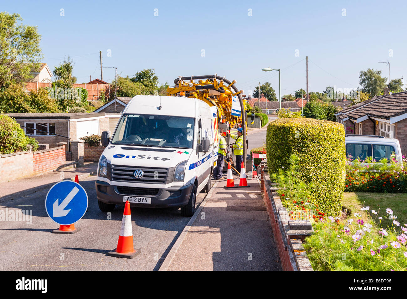 A contracted firm cleaning out the sewer pipes in the road and checking the pipes with a camera in the Uk - Stock Image
