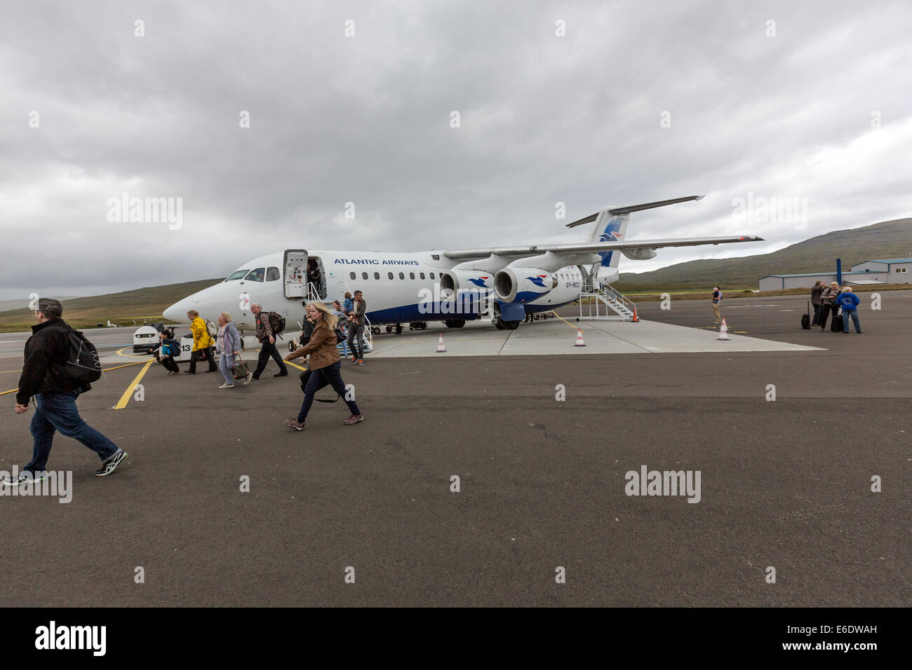 Passengers disembarking in the Atlantic Airways flight, AVRO  rj85, from London Stansted. Vágar Airport. - Stock Image