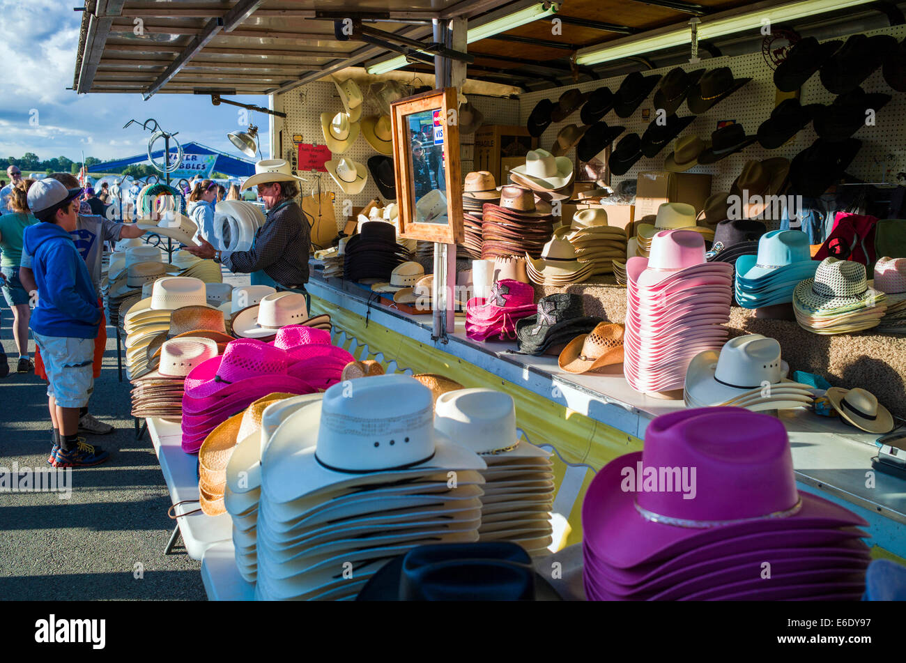 Visitors buying cowboy hats, Chaffee County Fair, Colorado, USA - Stock Image