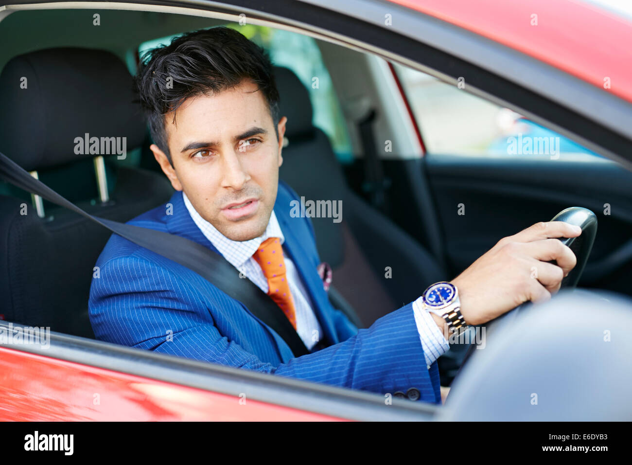 Man gesturing whilst driving car - Stock Image