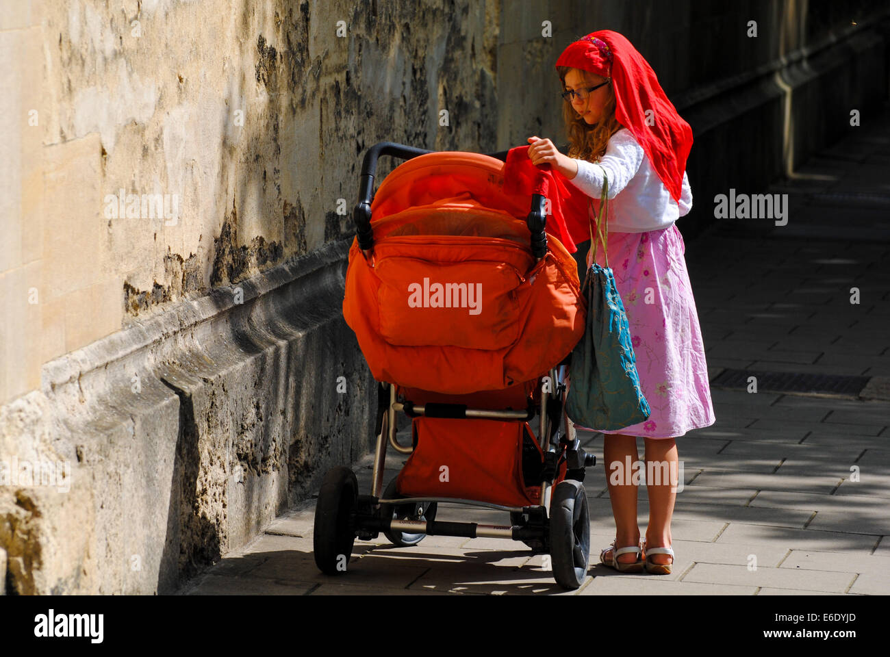 Young girl with a pram - Stock Image