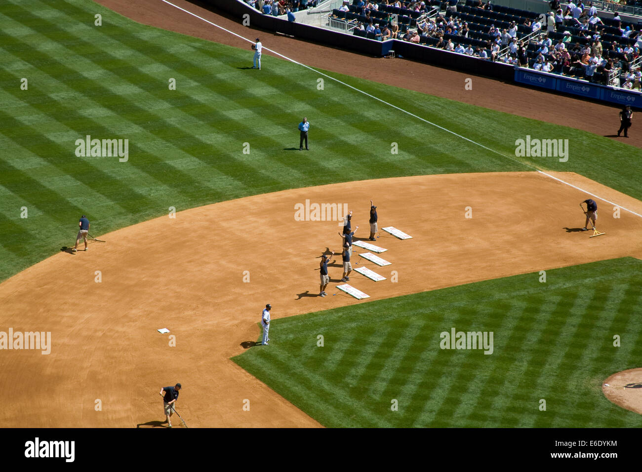 Ground Crew performing to the song 'YMCA' during 7th Inning stretch, Yankee Stadium (New), The Bronx, New York City, Stock Photo