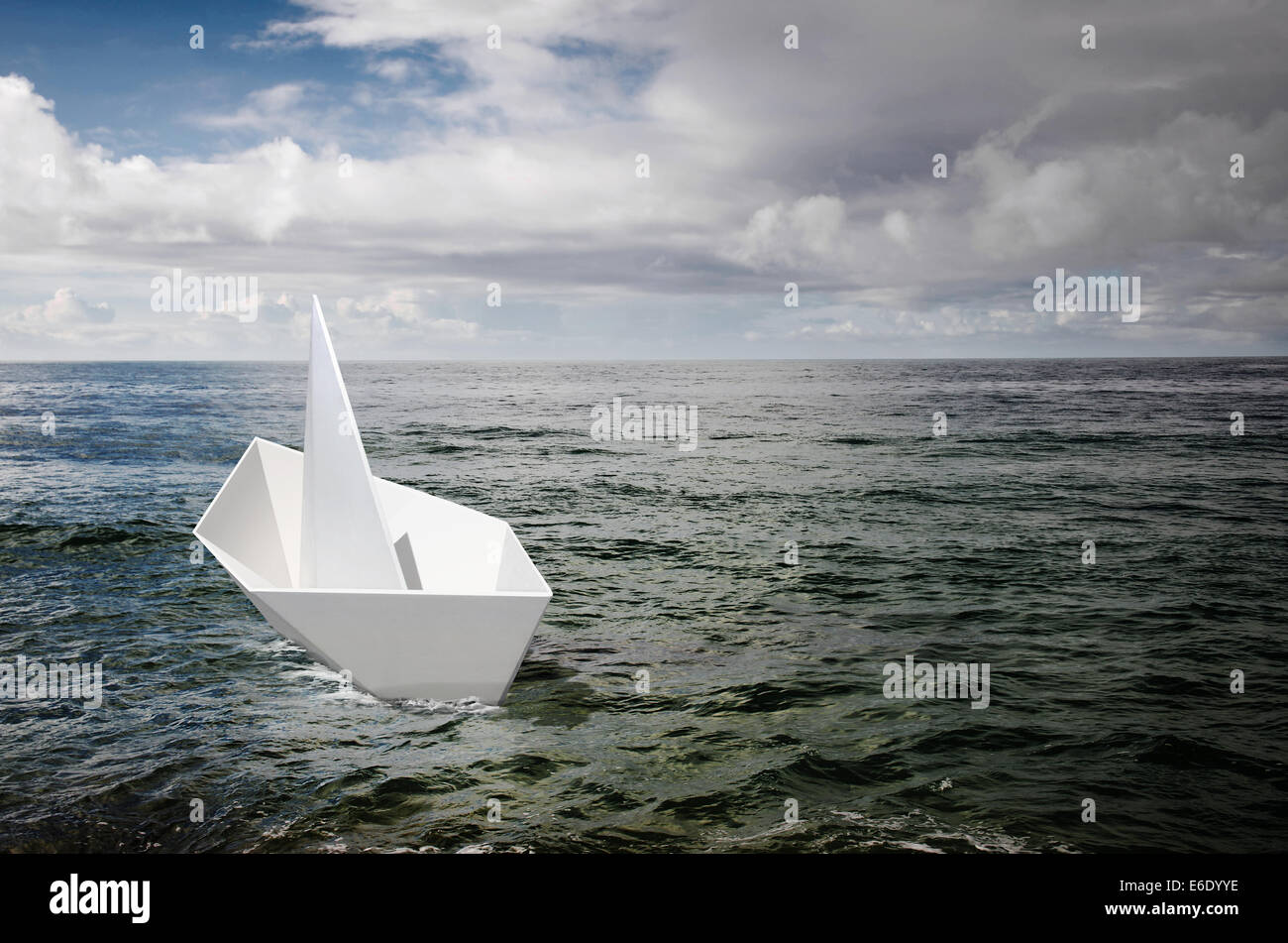 Single White Paper Boat Adrift In The Ocean Under A Stormy Sky