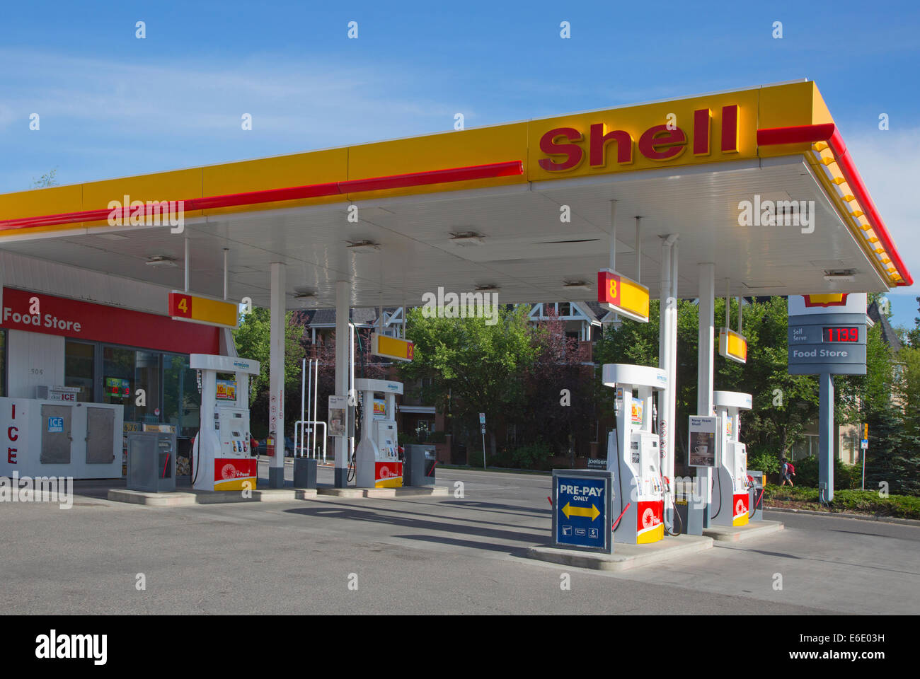 Shell service station with sign showing the price per liter in Canadian dollars Stock Photo