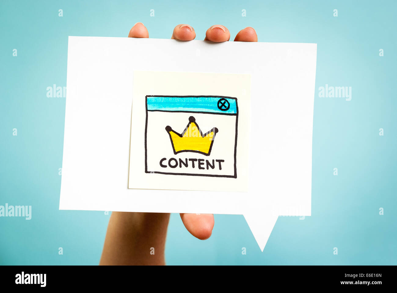 Yellow crown with content word on speech bubble and blue background. Social media concept. - Stock Image