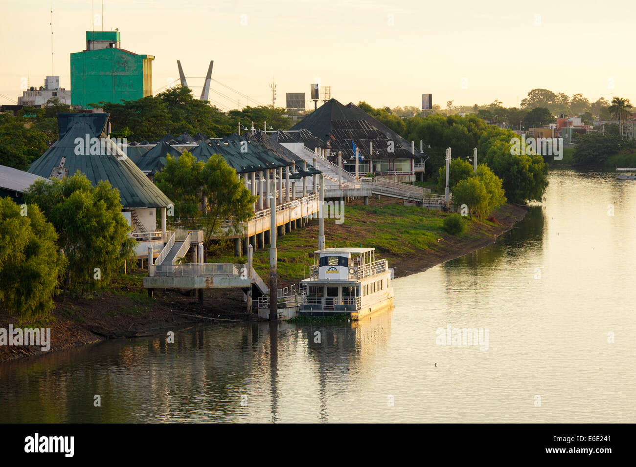 A river boat at sunset on the Grijalva River in Villahermosa, Tabasco, Mexico. - Stock Image