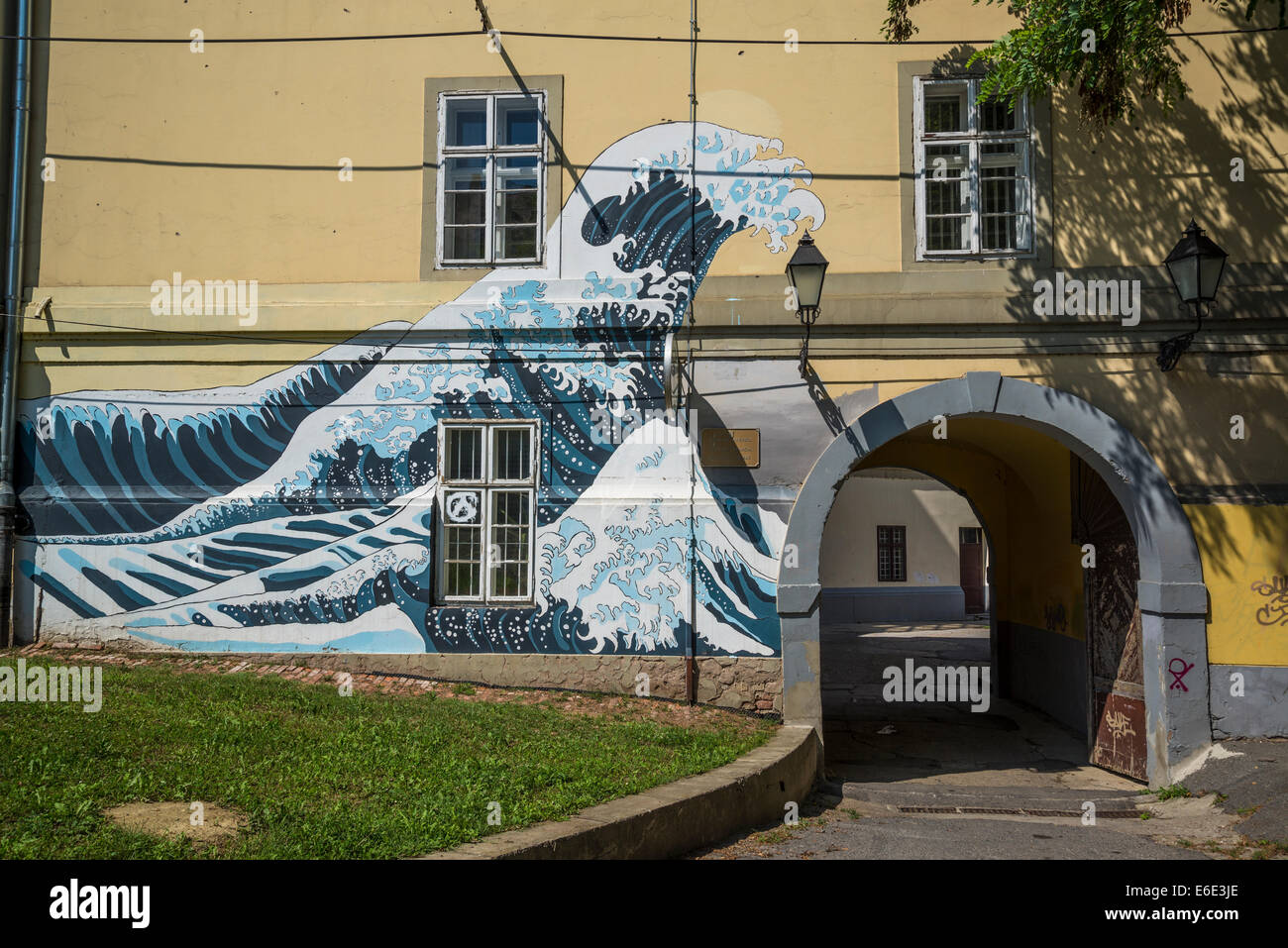Hokusai Wave painted at the entrance of Grammar School, Tvrdja, Osijek, Slavonia, Croatia - Stock Image