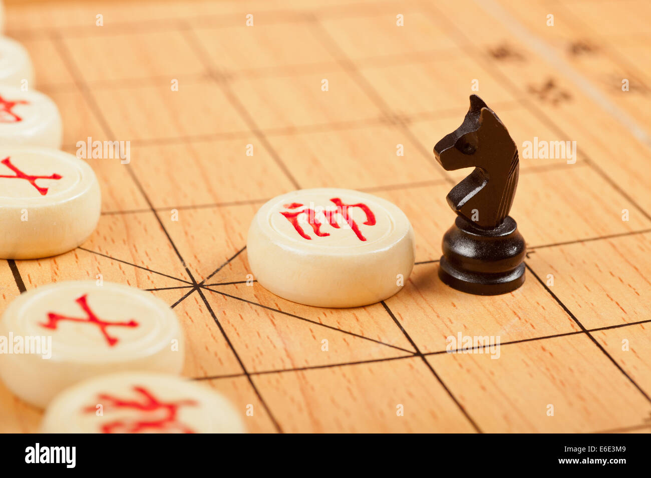 Western chess piece on Chinese chess board - Stock Image