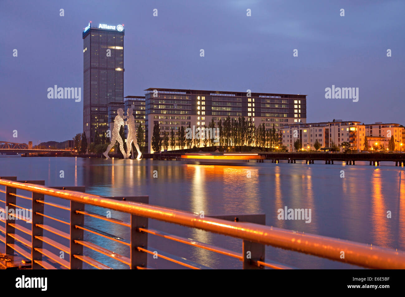 Molecule Man, artwork by American sculptor Jonathan Borofsky, and Treptowers building complex on the River Spree, - Stock Image